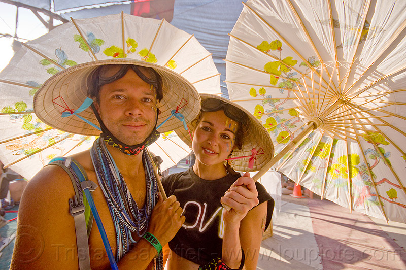 burning man 2013, burning man, center camp, conical hats, couple, hat, japanese umbrellas, straw hats, woman