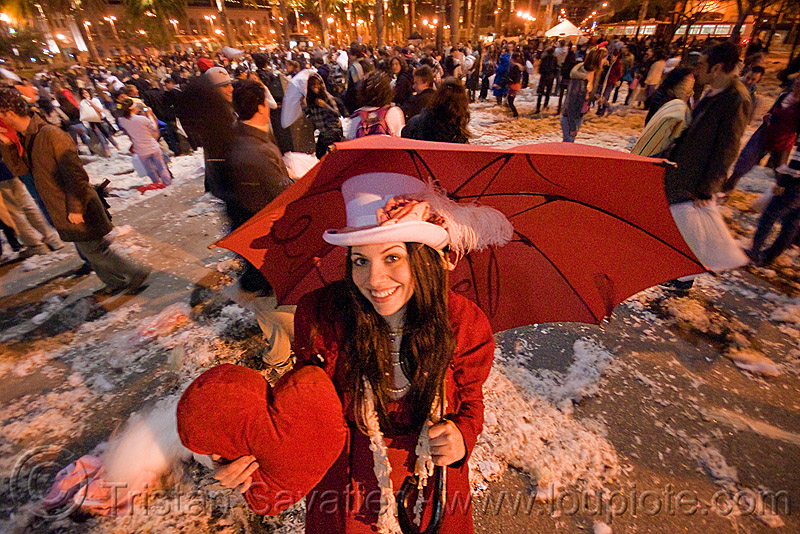 A woman with a heart - diana furka - the great san francisco pillow fight 2009, diana furka, down feathers, heart pillow, night, pillow fight club, pillows, red color, red umbrella, woman, world pillow fight day