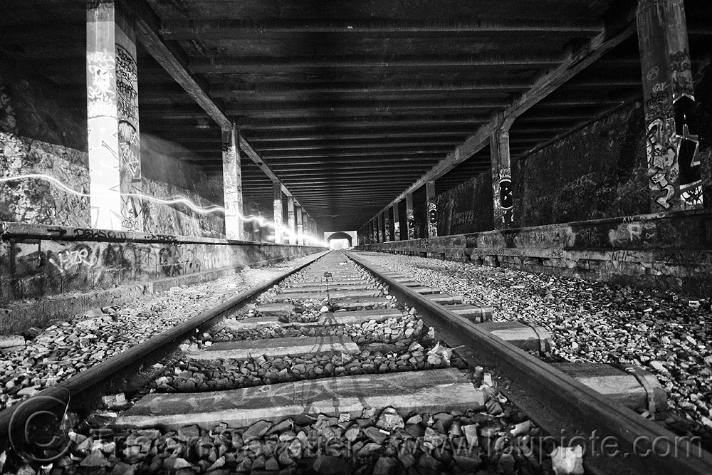 abandoned train tunnel, graffiti, long exposure, paris, perspective, petite ceinture, railroad tracks, rails, railway tunnel, train station, trespassing, urban exploration, vanishing point, stock photo