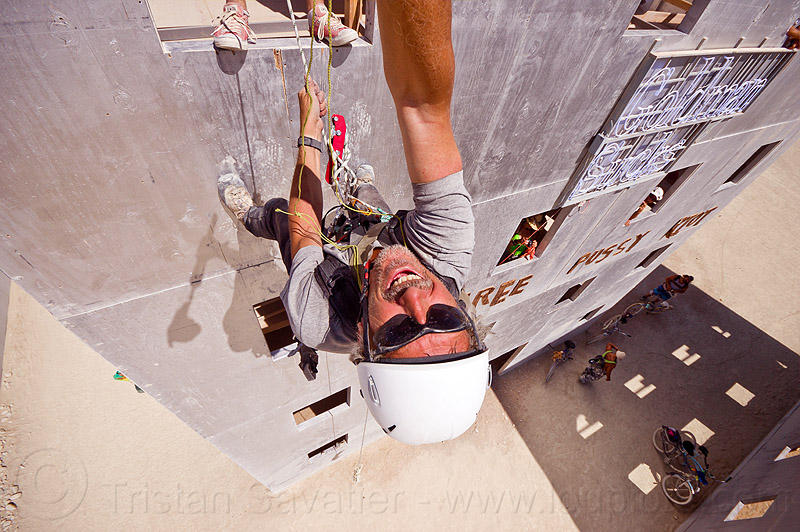 abseiling wall street building - burning man 2012, abseiling, buildings, burning man, climbing harness, climbing helmet, descender, descendeur, goldman sucks, mountaineering helmet, petzl, rappelling, rock climbing, selfie, selfportrait, single rope, static rope, tristan savatier, vertical, wall street