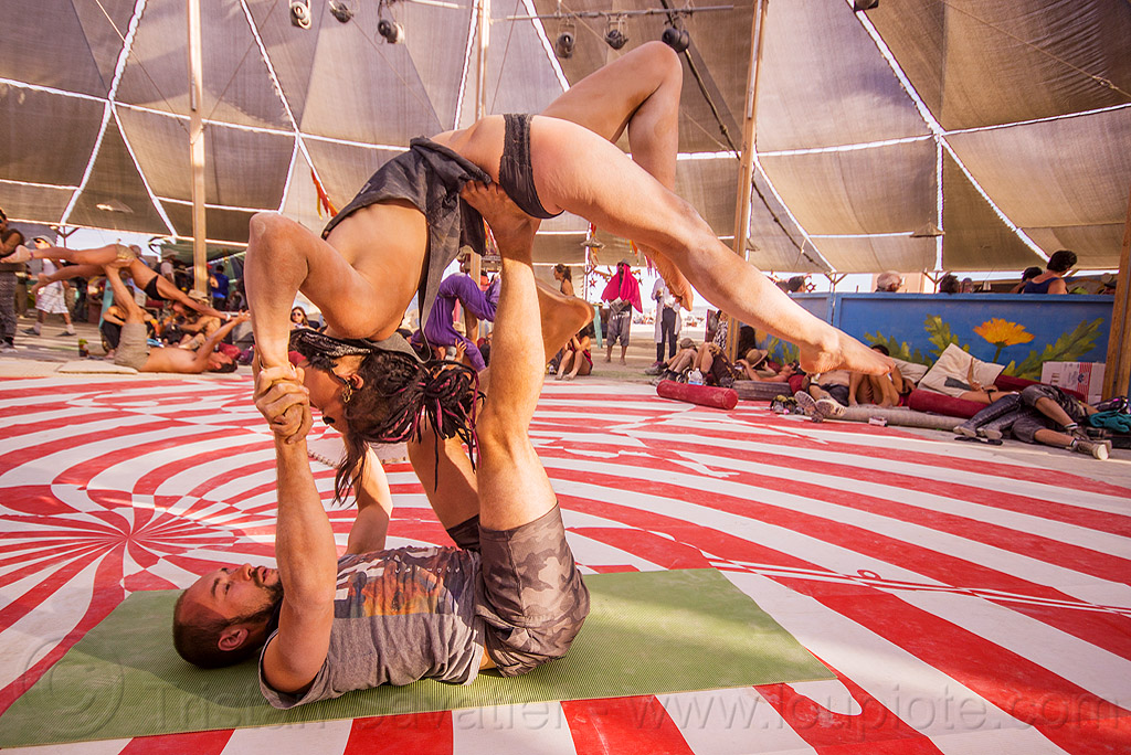 acro-yoga at center camp - burning man 2015, acro-yoga, azami, bending backward, burning man, center camp, couple, stretching, up-side-down, woman