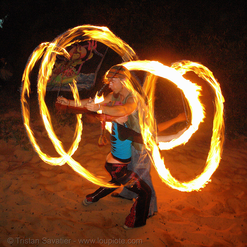 alex spinning poi with a girl (san francisco), fire dancer, fire dancing, fire performer, fire poi, fire spinning, flames, long exposure, night, shanti alex, spinning fire