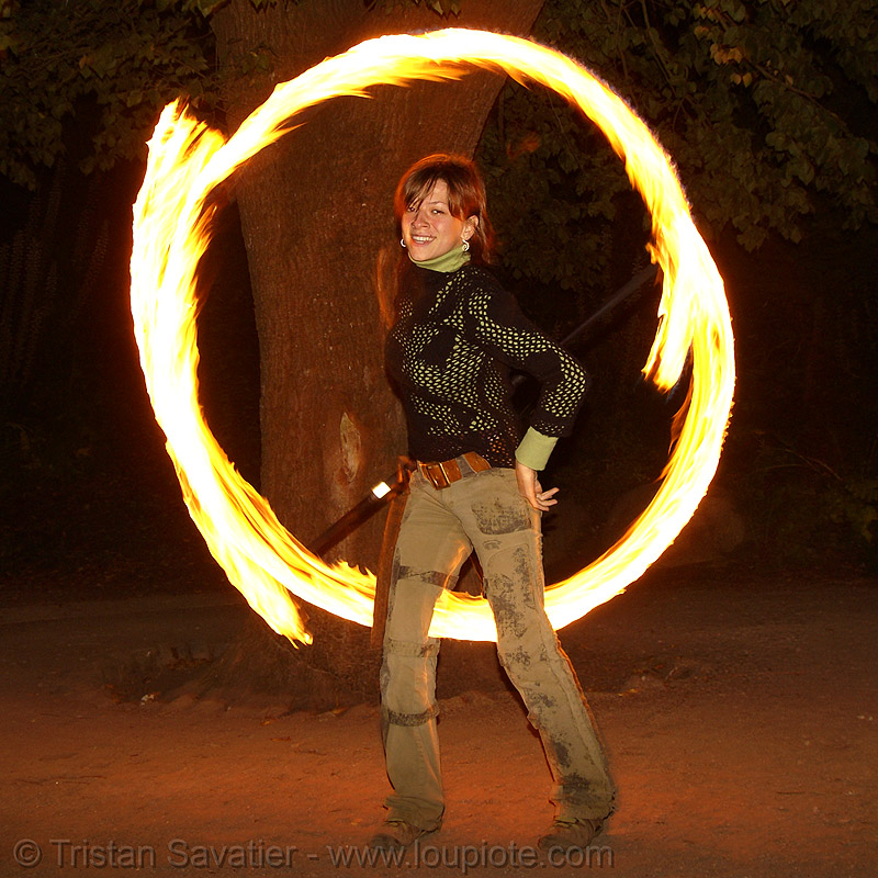 alissa spinning fire staff (san francisco), fire dancer, fire dancing, fire performer, fire spinning, flames, long exposure, night, people