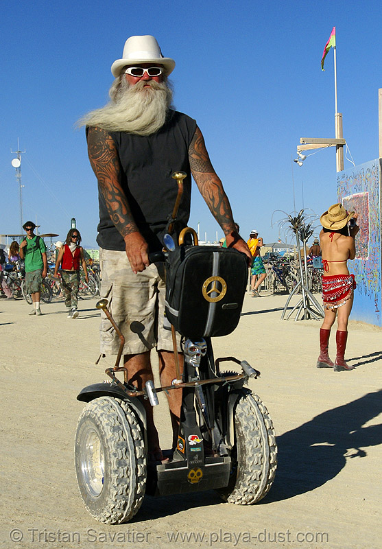 all-terrain segway, arms, arms tattoos, beard, burning man, hat, people, rupert, segway x2, tattooed, white hat