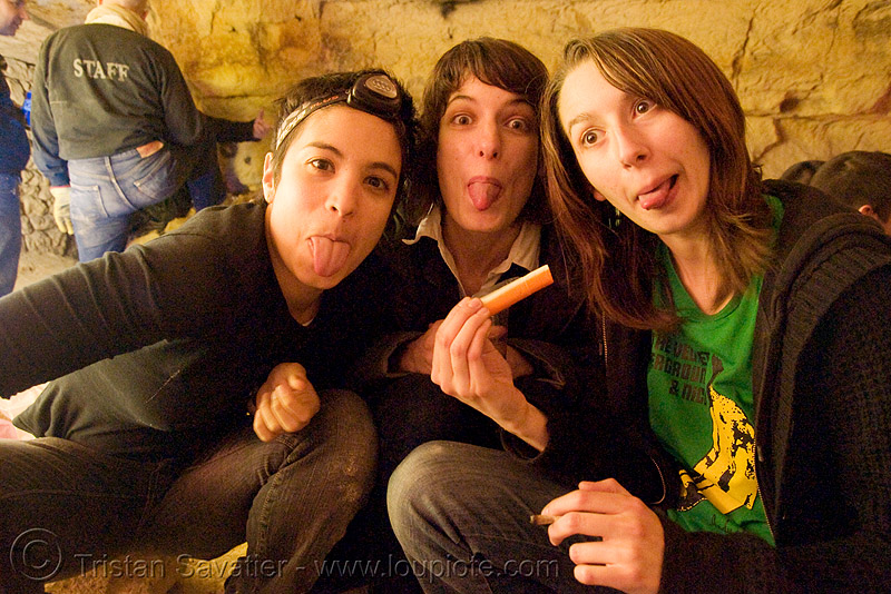 alyssa, gaëlle and coraline - catacombes de paris - catacombs of paris (off-limit area), alyssa, candles, catacombs of paris, cataphile, cave, gaëlle, girls, new year's eve 2008, sticking out tongue, sticking tongue out, tongues, underground quarry, women