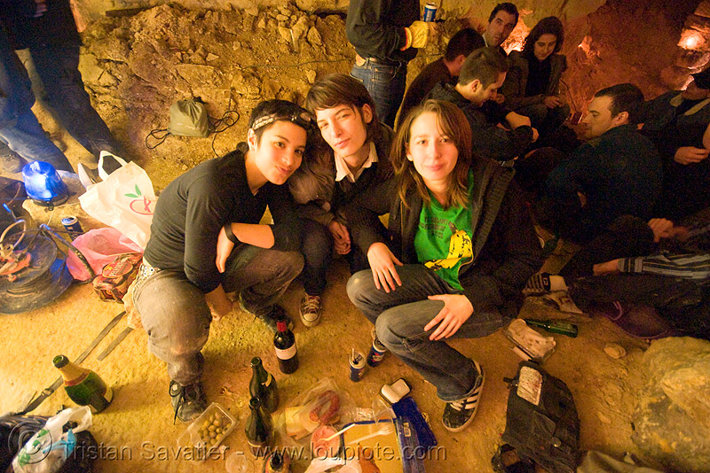 alyssa, gaëlle and coraline - catacombes de paris - catacombs of paris (off-limit area), candles, cataphile, cave, gaëlle, girls, new year's eve, new year's eve 2008, people, underground quarry, women