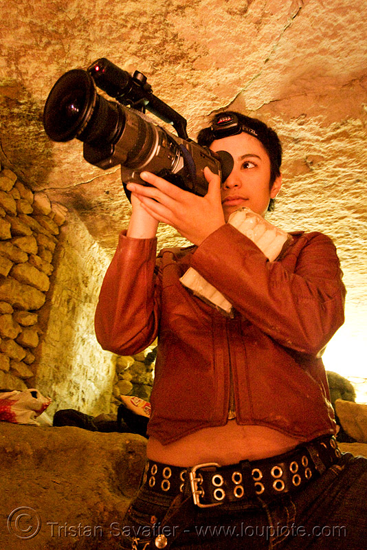 alyssa with video camera - catacombes de paris - catacombs of paris (off-limit area), androgynous, camcorder, candles, cataphile, cave, new year's eve, new year's eve 2008, people, shooting, underground quarry, woman