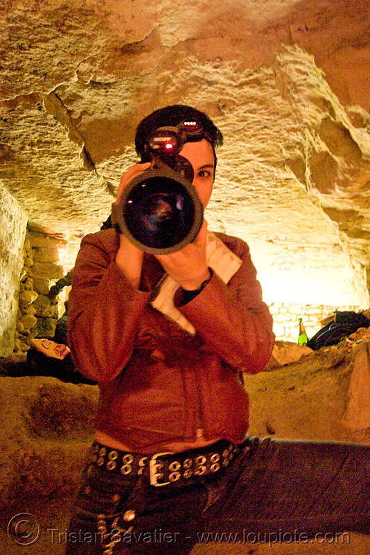alyssa with video camera - catacombes de paris - catacombs of paris (off-limit area), alyssa, androgynous, camcorder, candles, catacombs of paris, cataphile, cave, new year's eve 2008, shooting, underground quarry, video camera, woman