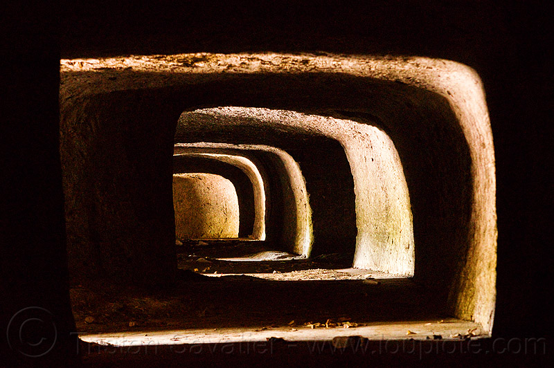 ancient tunnel in volcanic tuff, archaeology, bali, cave, curve, curved, shadow, sunlight, trespassing, urban exploration, urbex