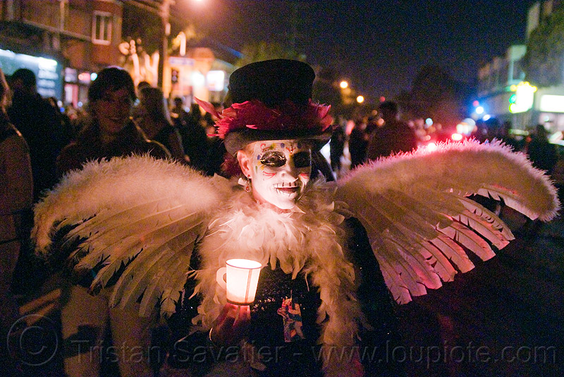 angel costume - white feather wings - Día de los muertos - halloween (san francisco), angel costume, angel wings, candle light, day of the dead, dia de los muertos, face painting, facepaint, feather wings, halloween, hat, makeup, night, white feathers, woman