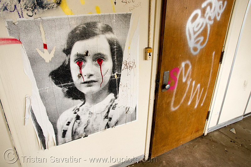 anne frank poster - desecrated, abandoned, abandoned building, abandoned hospital, ann frank, decay, desecration, graffiti, presidio hospital, presidio landmark apartments, street art, trespassing, urban exploration, vandalism, vandalized