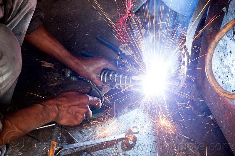 arc welding repair on motorbike shock (india), 350cc, arc welding, fixing, man, mechanic, motorbike, motorcycle, repairing, royal enfield bullet, shock absorber, sikkim, thunderbird, welder, worker, working