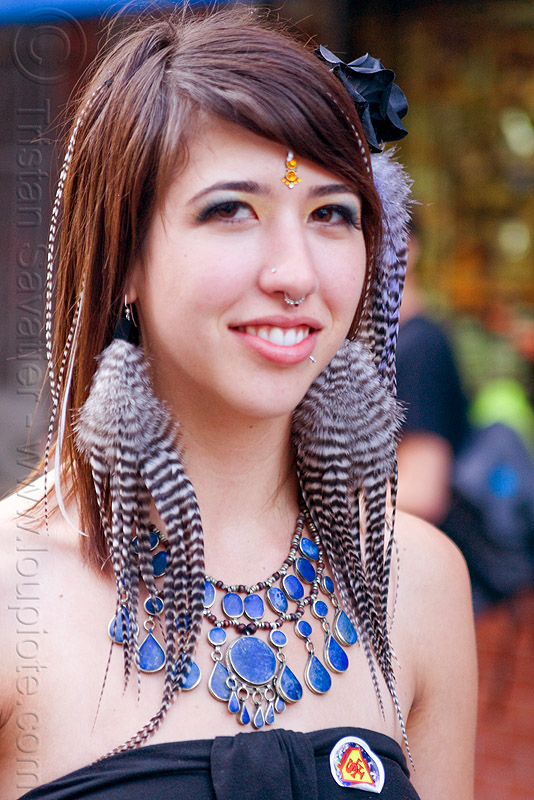 ariana francesca with her striped feather earrings, bindi, blue stone necklace, festival, how weird festival, people, woman