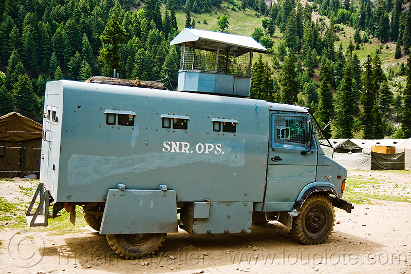 armored truck - amarnath yatra (pilgrimage) - kashmir, 4x4, all terrain, amarnath yatra, armored, armoured, blue, indian army, kashmir, lorry, military, mountain trail, mountains, pilgrimage, road, trekking, truck, vehicle, war, yatris, अमरनाथ गुफा
