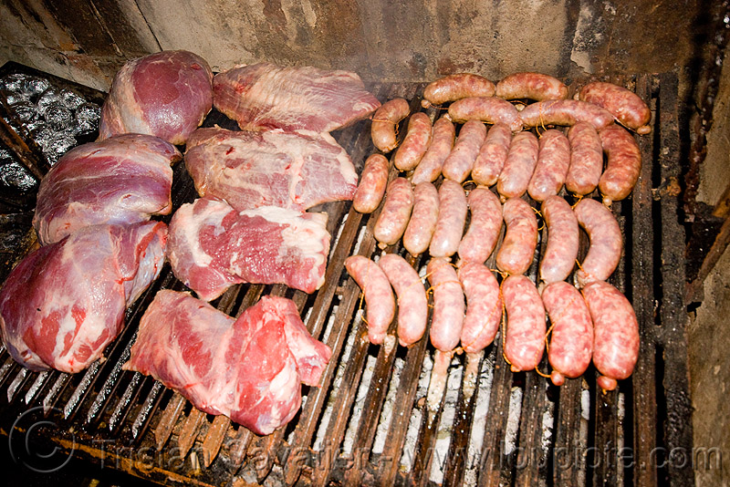asado - meat and chorizo BBQ, asado, barbecue, bbq, chorizo, grill, hostel clan, noroeste argentino, raw meat, sausages