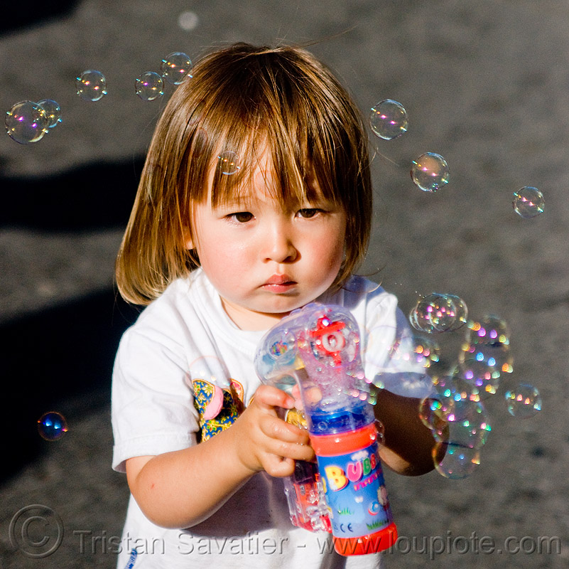 asian kid playing with bubble gun, boy, bubble gun, darius, haight street fair, kid, playing, soap bubbles, toddler, toy gun, young child