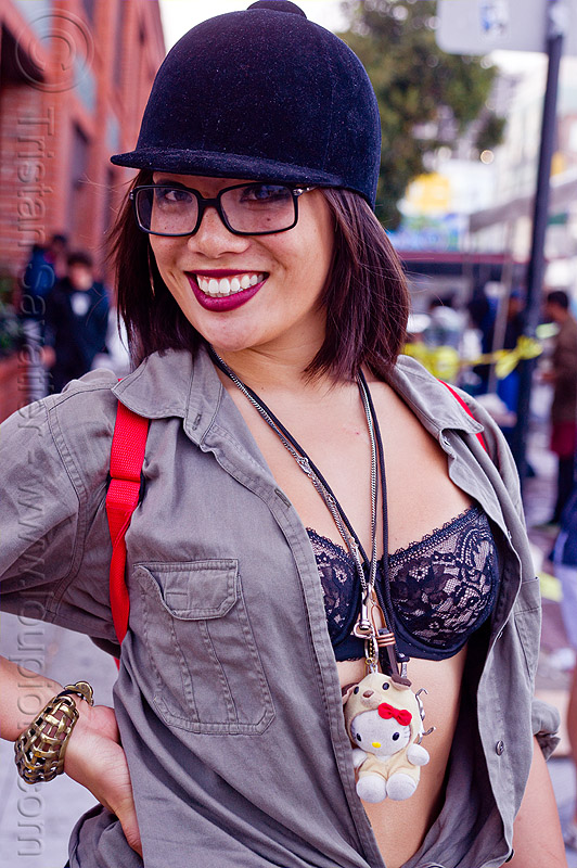 asian woman with equestrian helmet and lace bra, bracelet, equestrian helmet, folsom street fair, horse riding hat, lace bra, necklaces, open shirt, woman
