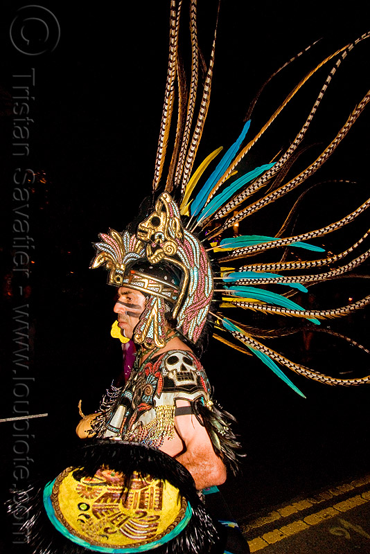aztec dancer with feathers - dia de los muertos - halloween (san francisco), aztec, costume, dancer, day of the dead, dia de los muertos, face painting, facepaint, feathers, halloween, makeup, man, mexican, night