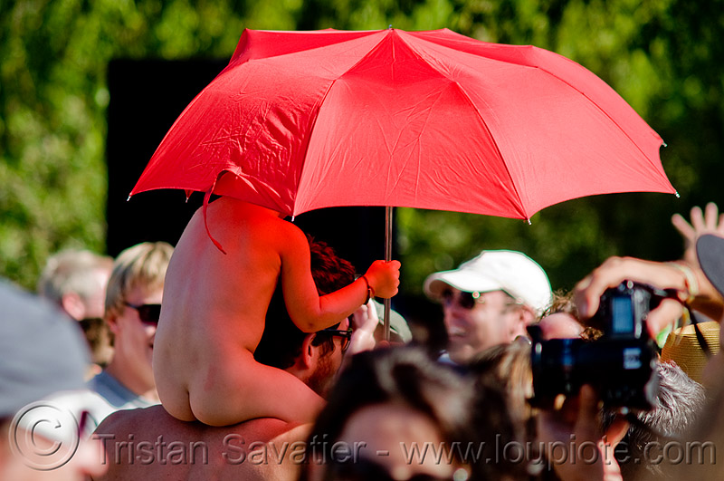 baby with red umbrella, baby, child, crowd, father, kid, red umbrella