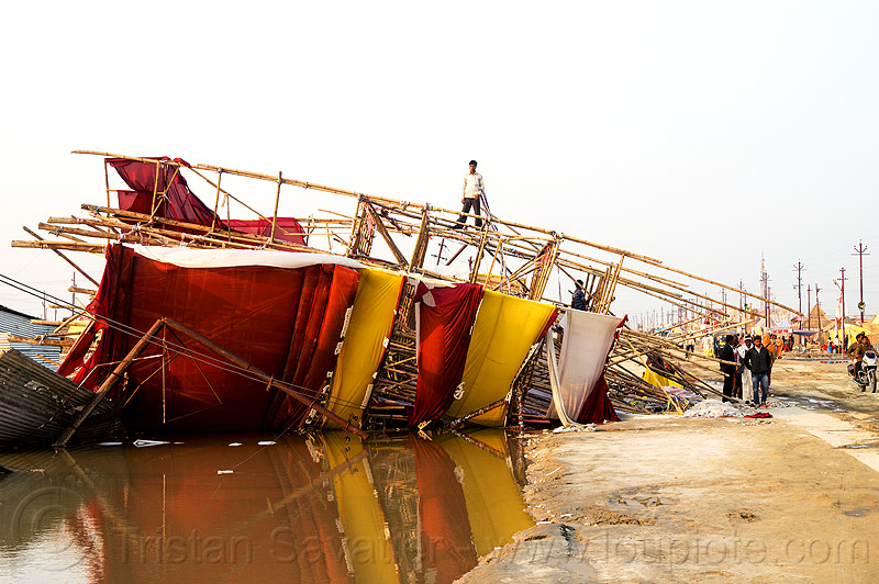 bamboo structure toppled by the wind storm - kumbh mela 2013 (india), ashram, broken, collapsed, destruction, flood, flooded, gate, hindu, hinduism, infrastructure, kumbha mela, maha kumbh, maha kumbh mela, people, street, water
