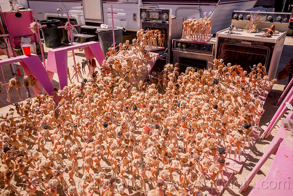 barbie dolls pushed into gas ovens - barbie death camp - burning man 2015, barbie death camp, barbie dolls, many, ovens