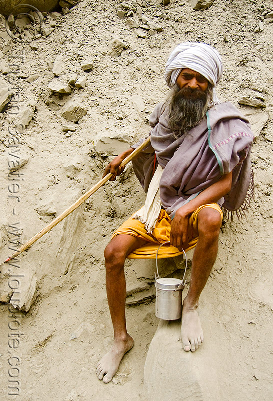 bare-feet sadhu (hindu holy man) - amarnath yatra (pilgrimage) - kashmir, amarnath yatra, baba, bare feet, barefoot, beard, hiking cane, hindu holy man, hinduism, kashmir, old man, pilgrim, pilgrimage, resting, sadhu, trekking, walking stick, yatris, अमरनाथ गुफा