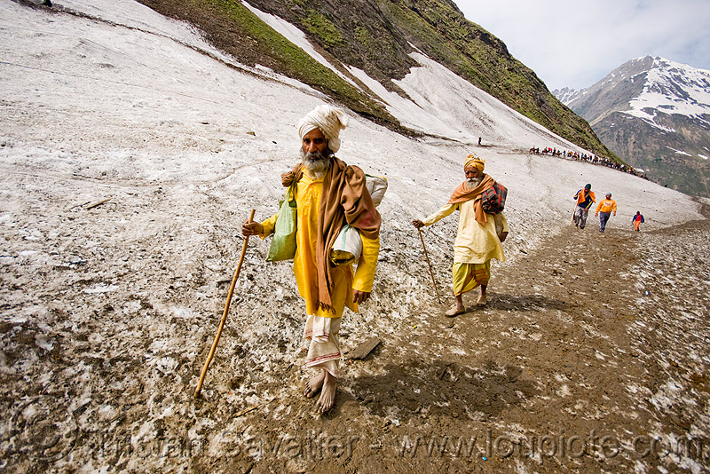 bare-feet sadhus (hindu holy men) on glacier trail - amarnath yatra (pilgrimage) - kashmir, babas, bare feet, barefoot, canes, hiking canes, hinduism, man, mountain trail, mountains, people, pilgrims, snow, trekking, walking sticks, yatris, अमरनाथ गुफा