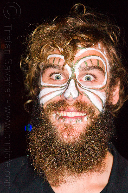 bearded man with face paint