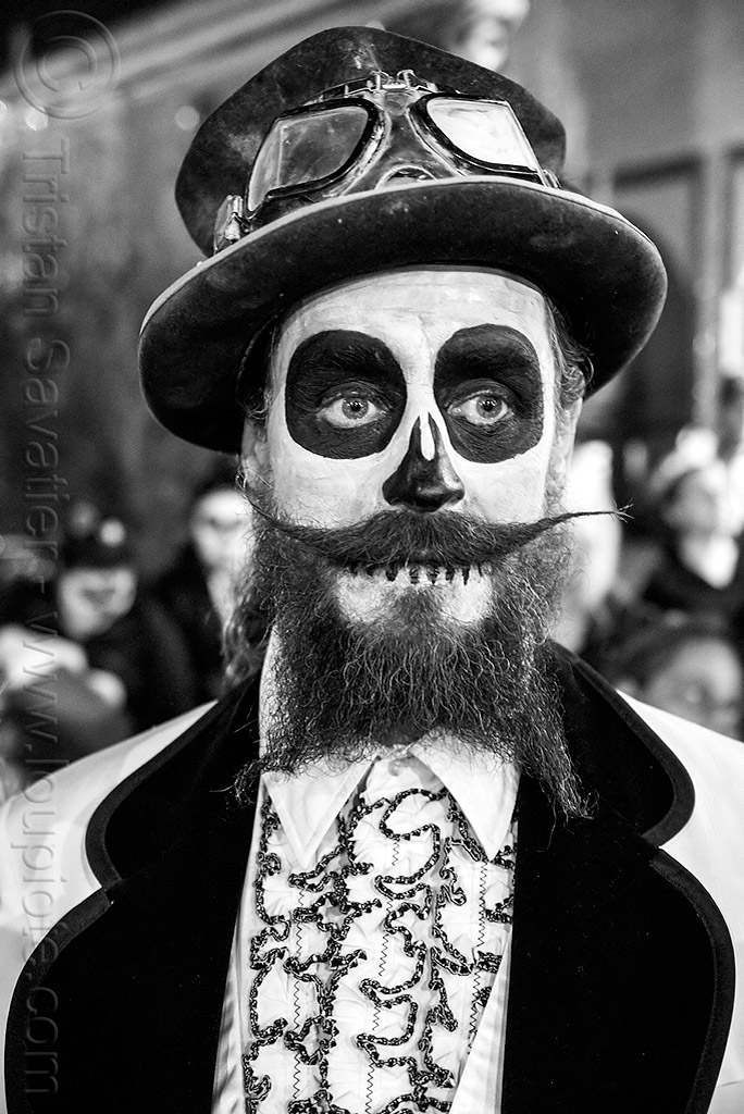 bearded man with skull makeup - steampunk costume - dia de los muertos, beard, day of the dead, dia de los muertos, face painting, facepaint, halloween, hat, lace shirt, man, mustache, night, steampunk, sugar skull makeup, vintage motorcycle googles