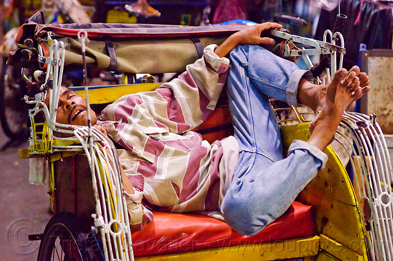 becak driver sleeping, bare feet, cycle rickshaw, java, jogja, jogjakarta, malioboro, man, napping, night, people, rickshaw driver, seat, street, yogyakarta