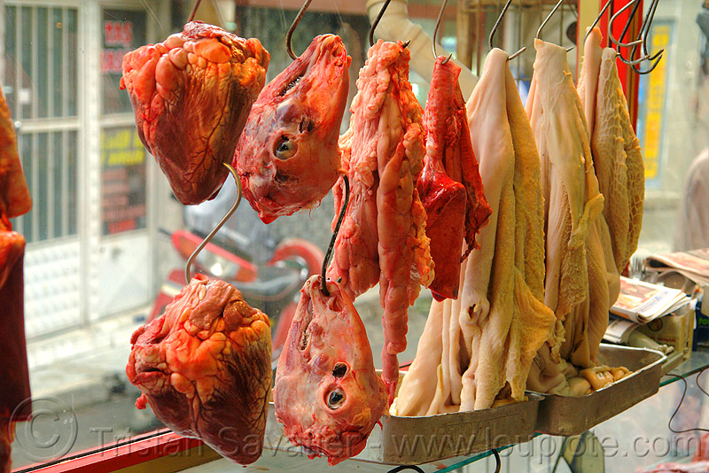 beef hearts, goat heads and tripe, beef hearts, chevon, goat heads, halal meat, hanging, hooks, intestin, meat market, meat shop, mutton, organs, raw meat, stomach, tripe