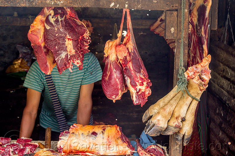 beef meat and cow feet hanging at meat market (india), butcher, east khasi hills, meat shop, meghalaya, people, pynursla, raw, raw meat