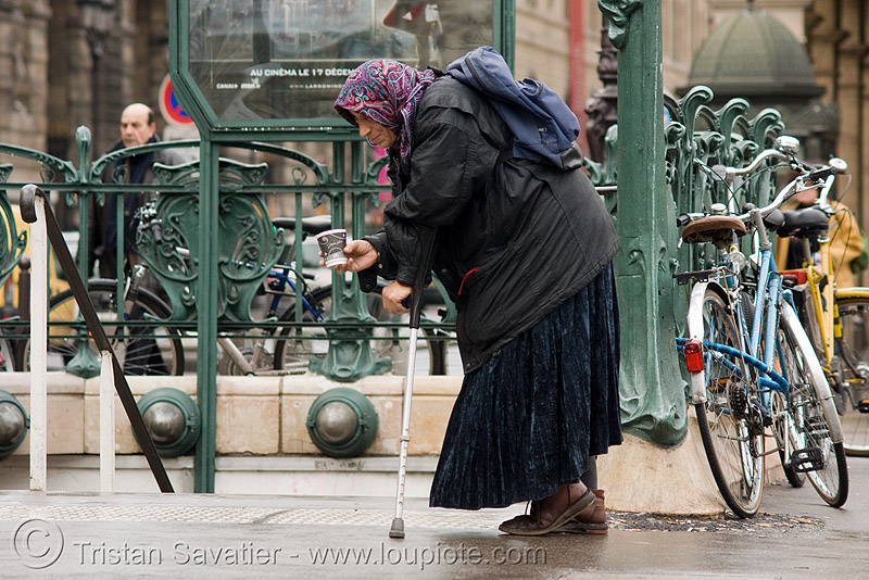 beggar - woman (paris), beggar, begging, crutch, head cover, metro entrance, metro station, paris, pauverty, poor, street, subway entrance, veil, woman