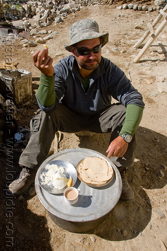ben having breakfast at pangong lake - ladakh (india), ben, breakfast, chai, chapati, india, ladakh, milk tea, spangmik, spice tea