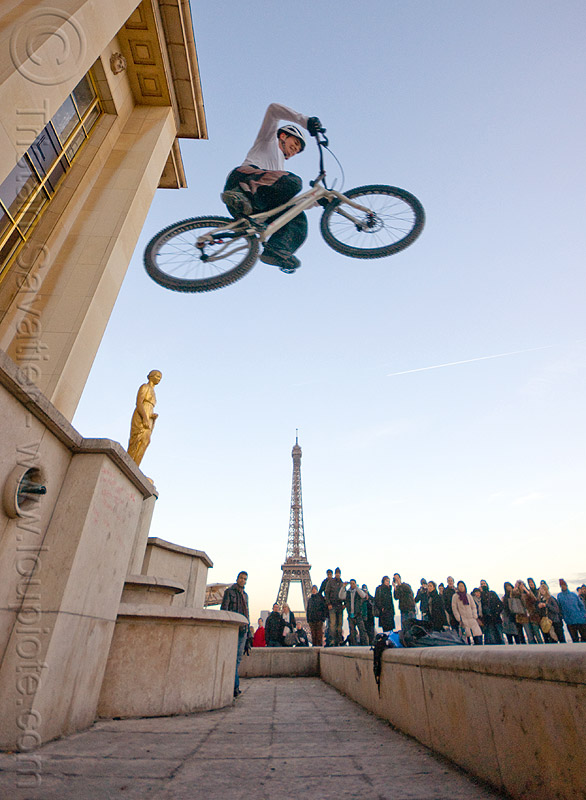 bicycle jumping over the eiffel tower, airborn, bicycle, bike trials, bmx, crowd, eiffel tower, freestyle, jump, man, mountain bike, mountain biking, palais de chaillot, paris, spectators, trial bike, trocadero, trocadéro, vtt