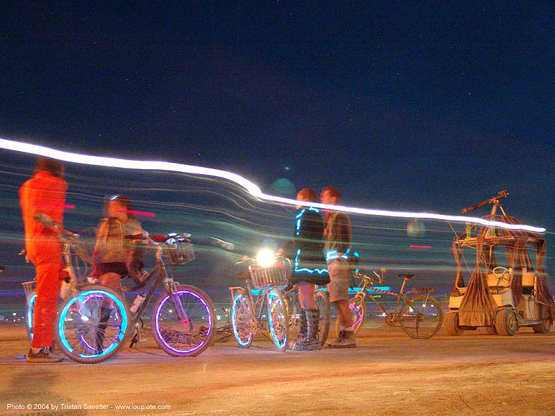 bicycles decorated with EL-wire - burning-man 2004, art, bikes, burning man, electroluminescent wire, long exposure, night
