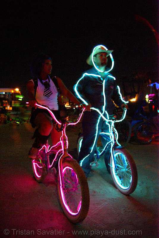bicycles with EL-wire - burning man 2007, burning man, el-wire costumes, electroluminescent wire, glowing, night