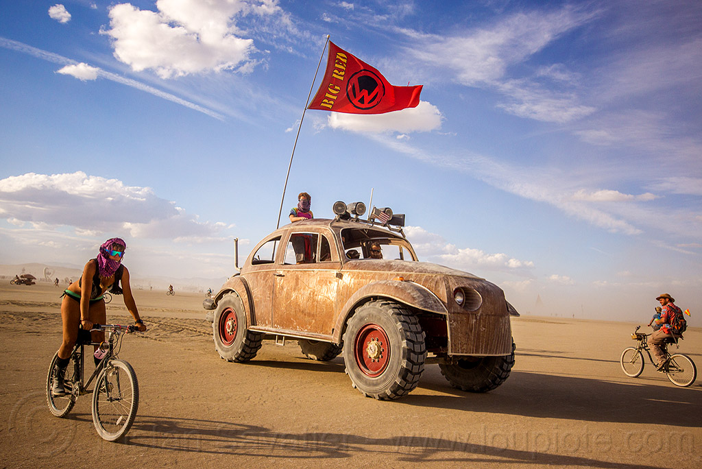 bigred - giant VW beetle art car - burning man 2015, bicycle, bigred art car, flag, people, red flag, ruth, volkswagen