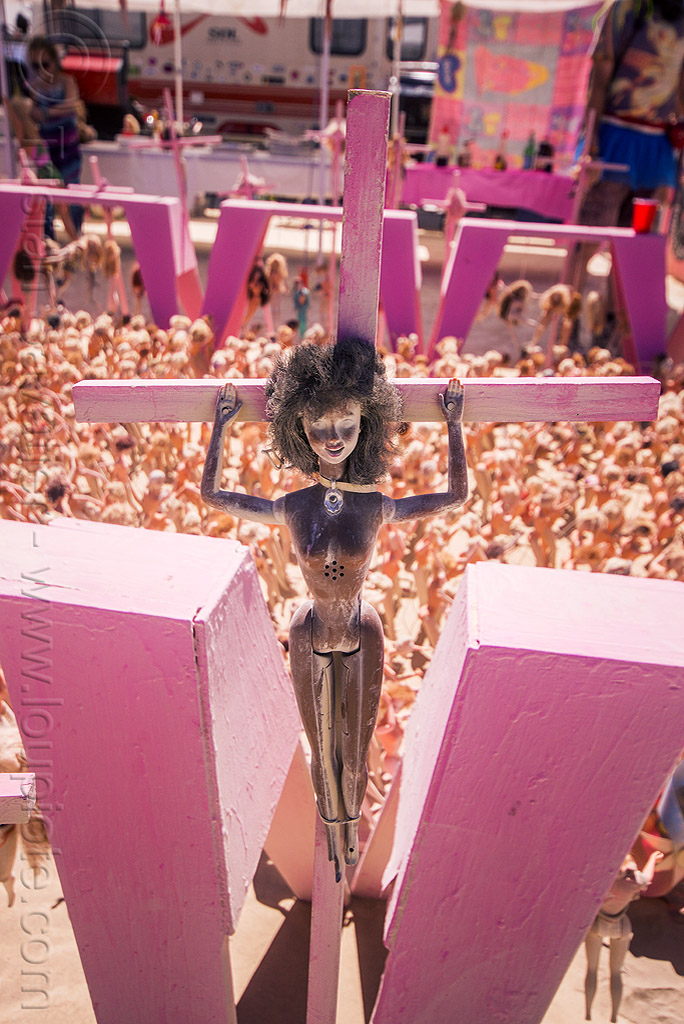 black barbie doll crucified - barbie death camp - burning man 2015, barbie death camp, barbie dolls, blasphemous, burning man, cross, crucified, crucifixion, pink