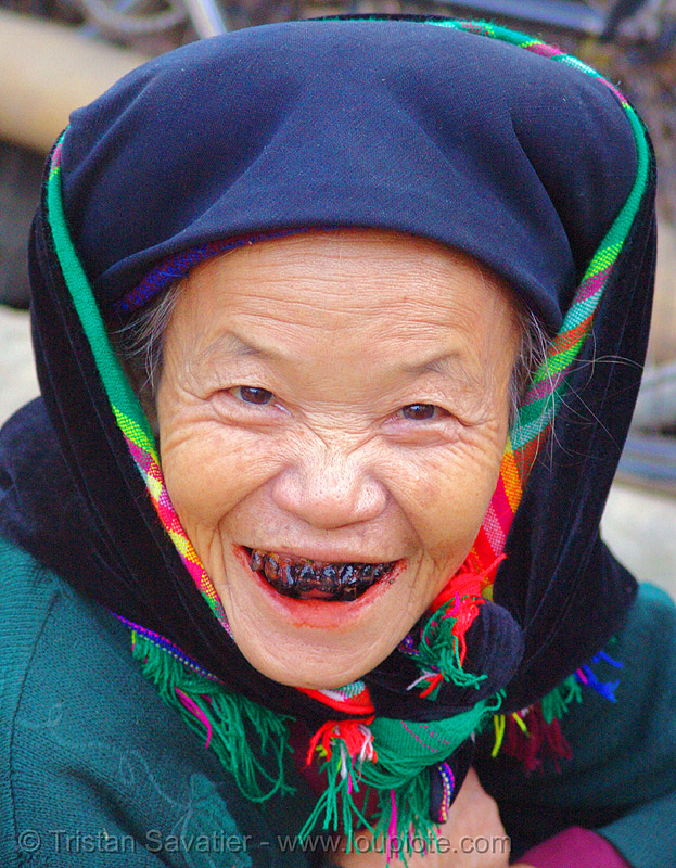 tribe woman with black teeth (a cultural and traditional sign of beauty), and bloody lips (caused by chewing betelnut) - vietnam, areca, areca nut, asian woman, betel, betel nut, betel quids, black-lacquered teeth, blackened teeth, bảo lạc, cau, hat, headwear, hill tribes, indigenous, lá trầu, mature woman, ohagura, old, old woman, people