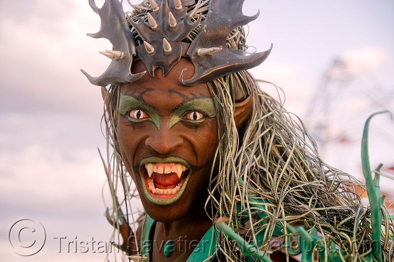 black vampire with cat-eye contacts, african american man, black man, burning man, cat eyes, cat-eye contact lenses, color contact lenses, contacts, special effects contact lenses, teeth, theatrical contact lenses, vampire fangs