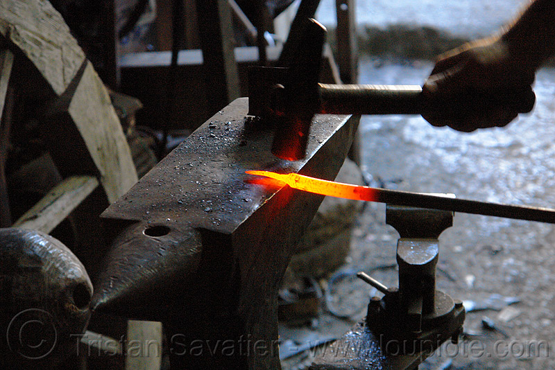 blacksmith hammering a red hot iron bar (turkey), anvil, blacksmith, forging, glowing, hammer, hand, ironwork, metal working, metalwork, nail, red hot, rod, tool
