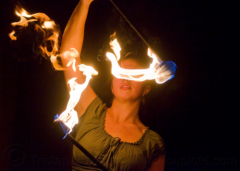 blinded by fire, double staff, fire dancer, fire dancing, fire performer, fire spinning, fire staffs, night, savanna, staves, woman