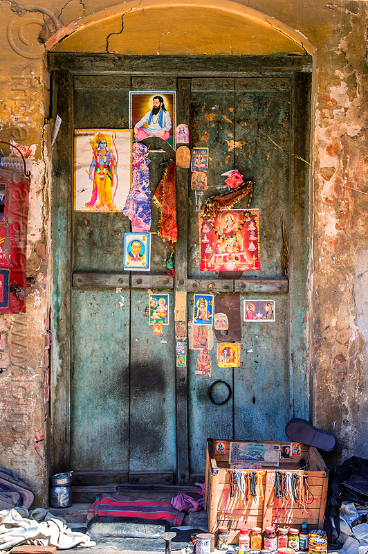 blue door decorated with posters of hindu deities and gurus (india), blue door, closed, deities, hindu, hinduism, posters, varanasi