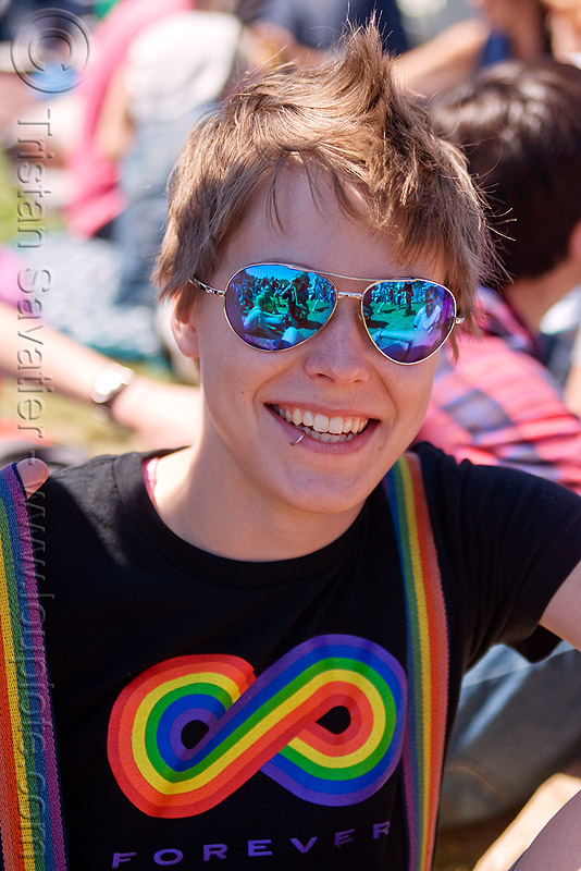 blue mirror sunglasses, blue sunglasses, gay pride festival, jess, lip piercing, mirror sunglasses, mohawk hair, rainbow colors, rainbow tshirt, woman