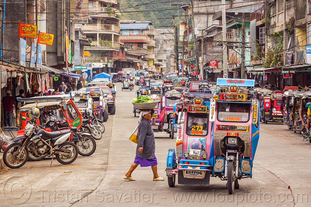 motorized tricycles - bontoc (philippines), bontoc, carrying on the head, crossing street, motorbikes, motorcycles, motorized tricycles, pedestrian, philippines, public transportation, sidecar, woman