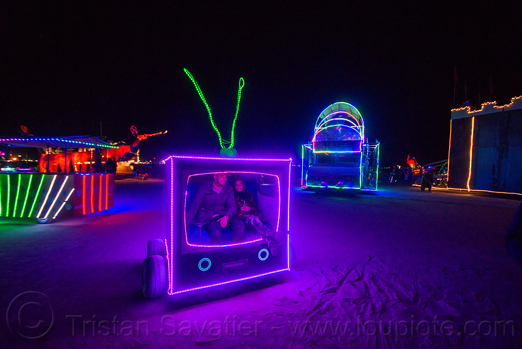 the boob tube - TV art car - burning man 2015, boob tube art car, burning man, glowing, night, television, tv