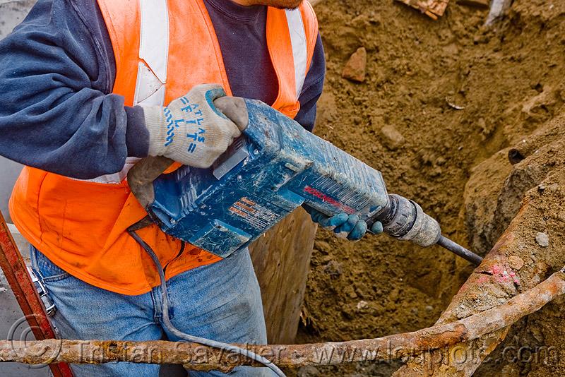 bosch hammer drill - electrical jackhammer - power tool - construction worker, drainage, earth, ground, heavy-duty, high-visibility jacket, high-visibility vest, industrial, people, reflective, reflective jacket, reflective vest, safety helmet, safety jacket, storm drain, utility worker, working