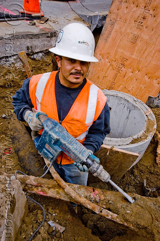 bosch hammer drill - electrical jackhammer - utility worker, construction, construction worker, drainage, earth, ground, heavy-duty, high-visibility jacket, high-visibility vest, industrial, people, power tool, reflective, reflective jacket, reflective vest, safety helmet, safety jacket, storm drain, working