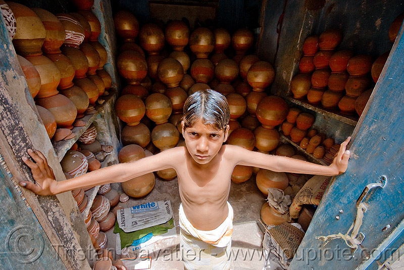boy guarding water-pots shop - jaipur (india), boy, door, india, jaipur, shop, water jugs, water pots